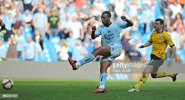 Manchester City's English forward Daniel Sturridge scores his team's fourth goal against West Bromwich Albion at The City of Manchester Stadium in...