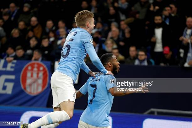 Manchester City's English forward Raheem Sterling celebrates after scoring a goal during the UEFA Champions League round of 16 first leg football...