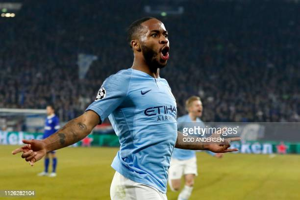 Manchester City's English forward Raheem Sterling celebrates after scoring the winning 23 goal during the UEFA Champions League round of 16 first leg...