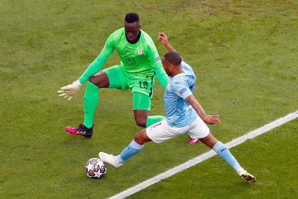 Manchester City's English forward Raheem Sterling controls the ball ahead of Chelsea's Senegalese goalkeeper Edouard Mendy during the UEFA Champions...