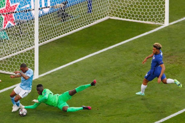 Manchester City's English forward Raheem Sterling is closed down by Chelsea's Senegalese goalkeeper Edouard Mendy during the UEFA Champions League...