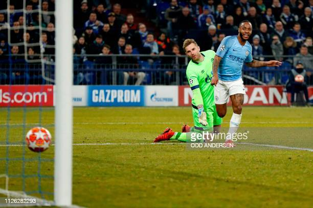 Manchester City's English forward Raheem Sterling scores the winning 23 goal in front of Schalke's German goalkeeper Ralf Faehrmann during the UEFA...