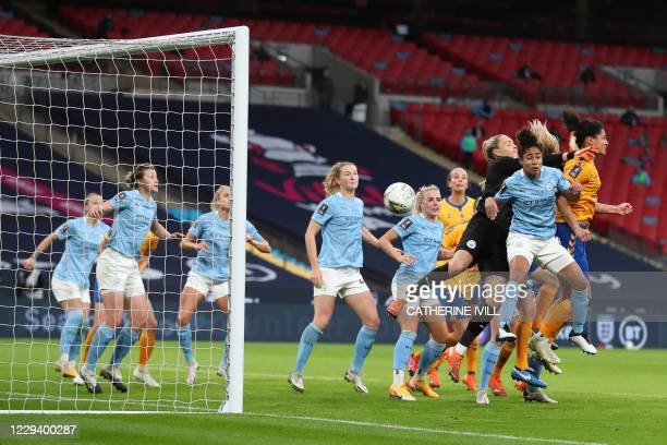 Manchester City's English goalkeeper Ellie Roebuck misses the ball as Everton's French striker Valerie Gauvin jumps to head the ball to score a goal...