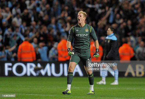 Manchester City's English goalkeeper Joe Hart celebrates after beating Manchester United during their English Premier League football match at The...
