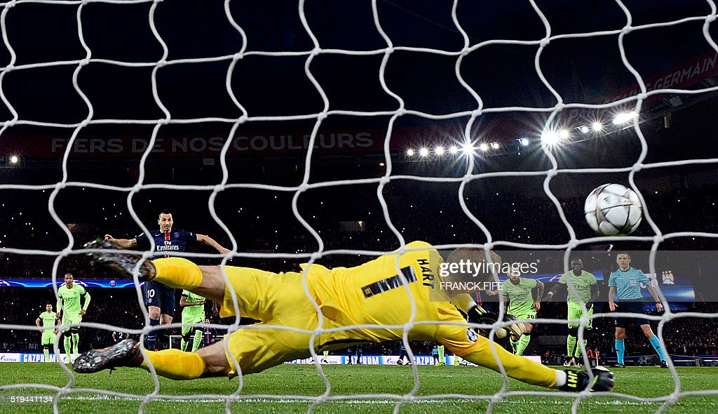 TOPSHOT - Manchester City's English goalkeeper Joe Hart jumps to catch the ball during the UEFA Champions League quarter final football match between Paris Saint Germain (PSG) and Manchester City on April 6, 2016 at the Parc des Princes stadium in Paris.