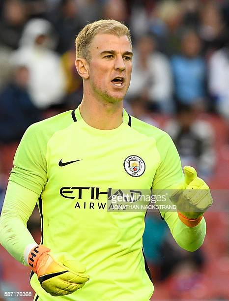 Manchester City's English goalkeeper Joe Hart reacts during a friendly football match between Arsenal and Manchester City at the Ullevi stadium in...