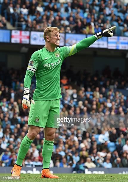 Manchester City's English goalkeeper Joe Hart reacts during the English Premier League football match between Manchester City and Queens Park Rangers...