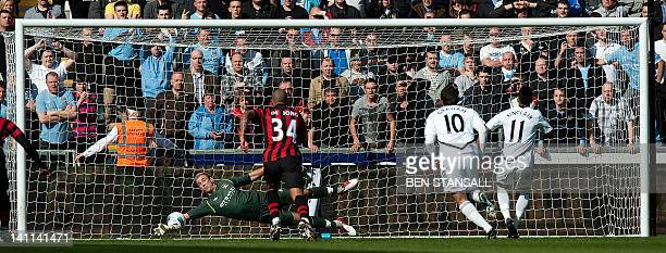 Manchester City's English goalkeeper Joe Hart saves a penalty from Swansea City's English midfielder Scott Sinclair during the English Premier League...