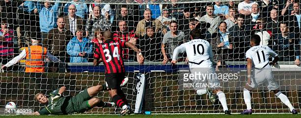 Manchester City's English goalkeeper Joe Hart saves a penatly from Swansea City's English midfielder Scott Sinclair during the English Premier League...
