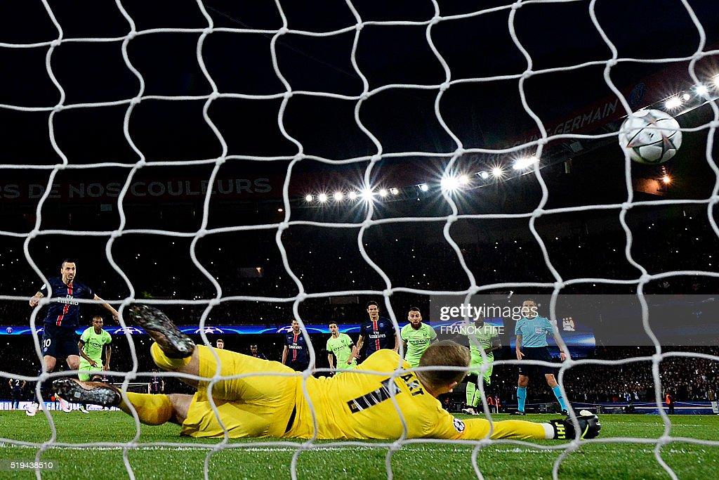 Manchester City's English goalkeeper Joe Hart stops a penalty kick during the UEFA Champions League quarter final football match between Paris Saint Germain (PSG) and Manchester City on April 6, 2016 at the Parc des Princes stadium in Paris.