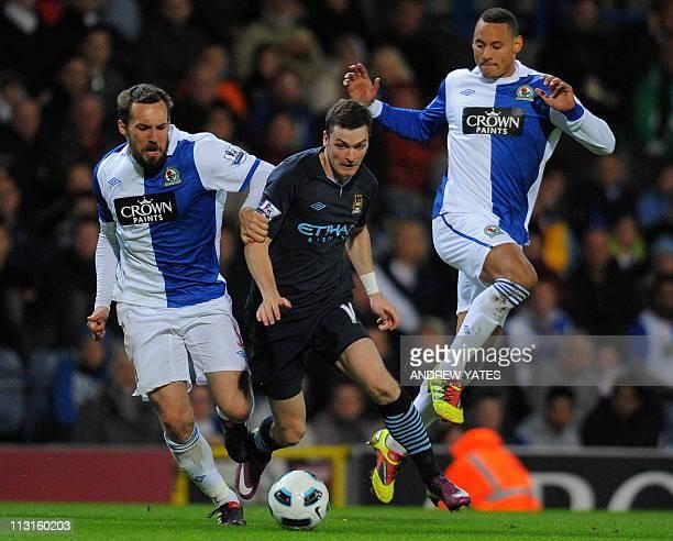 Manchester City's English midfielder Adam Johnson vies with Blackburn Rovers' US defender Jermaine Jones and Blackburn Rovers' French defender Gael...