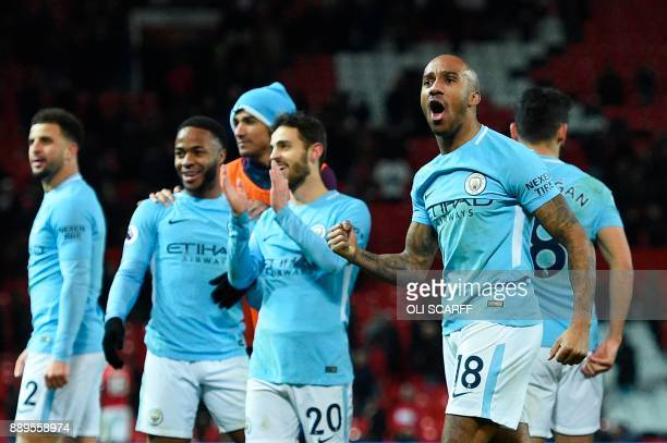 Manchester City's English midfielder Fabian Delph celebrates at the end of the English Premier League football match between Manchester United and...
