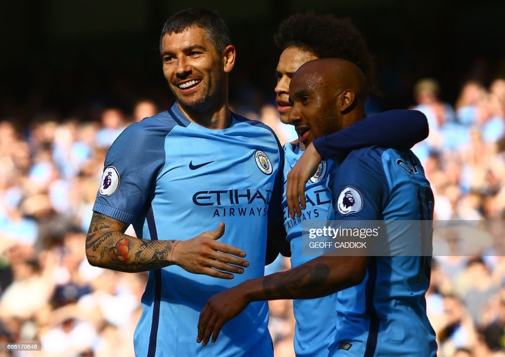 Manchester City's English midfielder Fabian Delph (R) celebrates scoring his team's third goal during the English Premier League football match between Manchester City and Hull City at the Etihad Stadium in Manchester, north west England, on April 8, 2017. / AFP PHOTO / Geoff CADDICK / RESTRICTED TO EDITORIAL USE. No use with unauthorized audio, video, data, fixture lists, club/league logos or 'live' services. Online in-match use limited to 75 images, no video emulation. No use in betting, games or single club/league/player publications. /