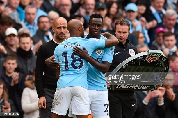 Manchester City's English midfielder Fabian Delph leaves the pitch after being substituted off for Manchester City's French defender Benjamin Mendy...