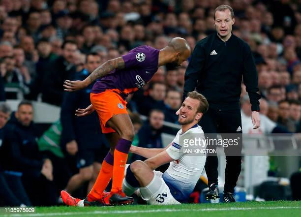 Manchester City's English midfielder Fabian Delph remostrates with Tottenham Hotspur's English striker Harry Kane before Kane laeft the pitch injured...