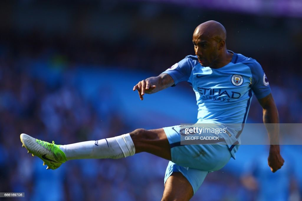 Manchester City's English midfielder Fabian Delph scores his team's third goal during the English Premier League football match between Manchester City and Hull City at the Etihad Stadium in Manchester, north west England, on April 8, 2017. / AFP PHOTO / Geoff CADDICK / RESTRICTED TO EDITORIAL USE. No use with unauthorized audio, video, data, fixture lists, club/league logos or 'live' services. Online in-match use limited to 75 images, no video emulation. No use in betting, games or single club/league/player publications. /
