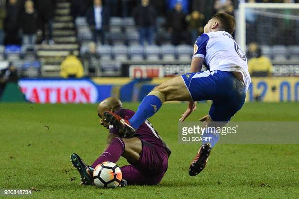 Manchester City's English midfielder Fabian Delph tackle on Wigan Athletic's English midfielder Max Power leads to a red card during the English FA...