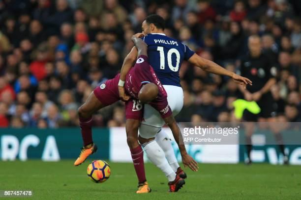 Manchester City's English midfielder Fabian Delph vies with West Bromwich Albion's Englishborn Scottish midfielder Matt Phillips during the English...