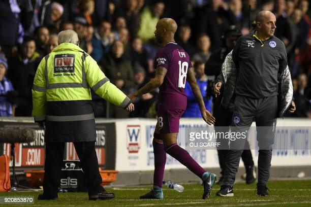 Manchester City's English midfielder Fabian Delph walks off the pitch during the English FA Cup fifth round football match between Wigan Athletic and...
