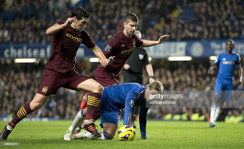 """Manchester City's English midfielder Gareth Barry (L) and Matija Nastasi (2nd L) challenge Chelsea's Spanish forward Fernando Torres (C) during the English Premier League football match between Chelsea and Manchester City at Stamford Bridge stadium in London on November 25, 2012. USE. No use with unauthorized audio, video, data, fixture lists, club/league logos or """"live"""" services. Online in-match use limited to 45 images, no video emulation. No use in betting, games or single club/league/player publications"""