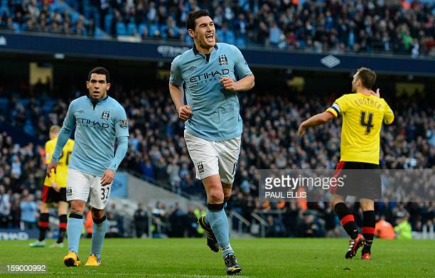 Manchester City's English midfielder Gareth Barry celebrates after scoring the second goal during the English FA Cup third round football match...