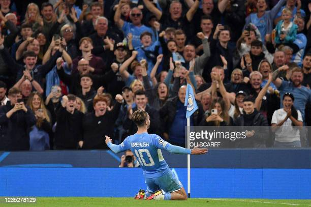 Manchester City's English midfielder Jack Grealish celebrates scoring his team's fourth goal in front of the home supporters during the UEFA...