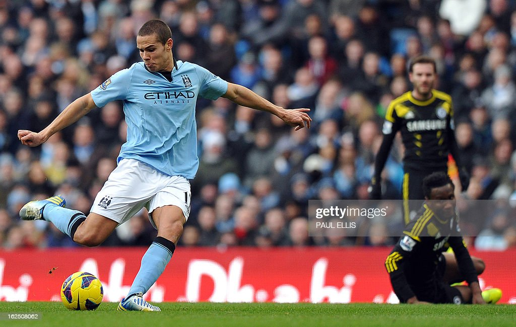 """Manchester City's English midfielder Jack Rodwell (L) shoots during the English Premier League football match between Manchester City and Chelsea at the Etihad Stadium in Manchester, northwest England, on February 24, 2013. USE. No use with unauthorized audio, video, data, fixture lists, club/league logos or """"live"""" services. Online in-match use limited to 45 images, no video emulation. No use in betting, games or single club/league/player publications."""