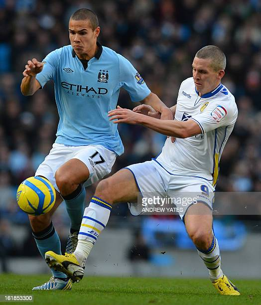 Manchester City's English midfielder Jack Rodwell vies with Leeds United's Welsh striker Steve Morison during the fifth round English FA Cup football...