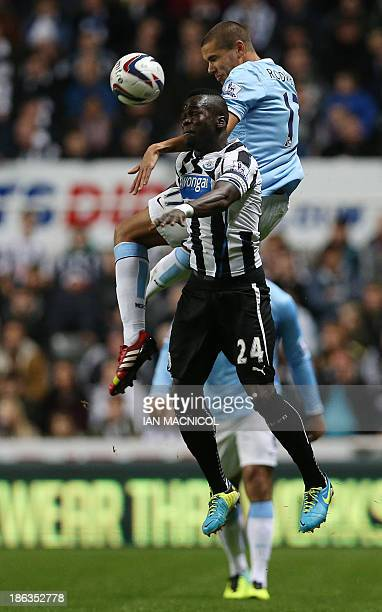 Manchester City's English midfielder Jack Rodwell vies with Newcastle United's Ivorian midfielder Cheick Tiote during the English League Cup fourth...