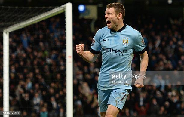 Manchester City's English midfielder James Milner celebrates scoring his team's first goal during the English FA Cup third round football match...