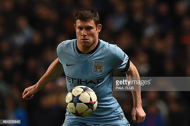 Manchester City's English midfielder James Milner controls the ball during the UEFA Champions League round of 16 first leg football match between...