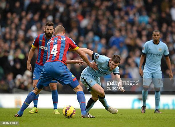 Manchester City's English midfielder James Milner vies with Crystal Palace's USborn Norwegian defender Brede Hangeland during the English Premier...