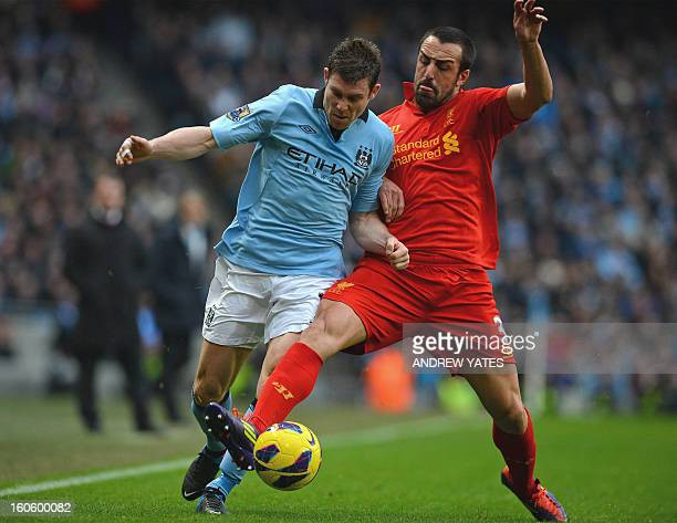 Manchester City's English midfielder James Milner vies with Liverpool's Spanish defender Jose Enrique during the English Premier League football...