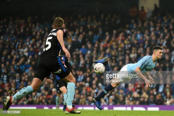 TOPSHOT Manchester City's English midfielder Phil Foden attempts a scorpian kick unsuccessfully during the English FA Cup third round football match...