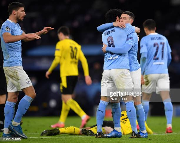 Manchester City's English midfielder Phil Foden celebrates scoring his team's second goal with Manchester City's German midfielder Ilkay Gundogan...