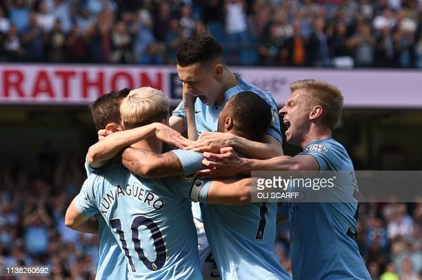 Manchester City's English midfielder Phil Foden celebrates scoring the opening goal during the English Premier League football match between...