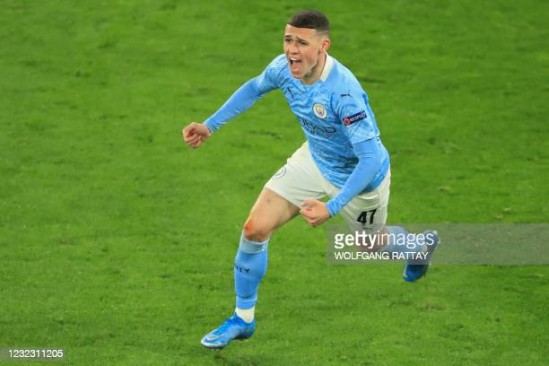 Manchester City's English midfielder Phil Foden celebrates scoring the 1-2 goal during the UEFA Champions League quarter-final second leg football...