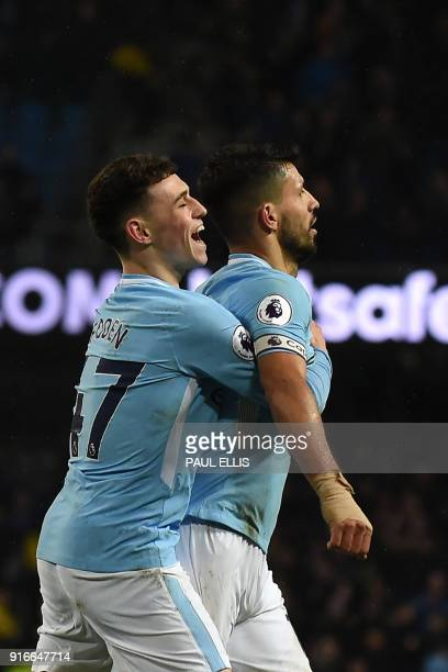 Manchester City's English midfielder Phil Foden congratulates Manchester City's Argentinian striker Sergio Aguero on scoring their fifth goal his...