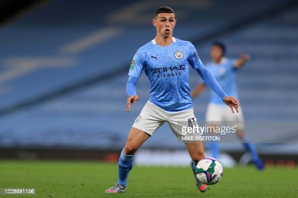Manchester City's English midfielder Phil Foden looks to play a pass during the English League Cup third round football match between Manchester City...