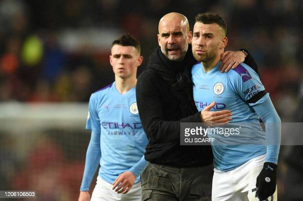 Manchester City's English midfielder Phil Foden, Manchester City's Spanish manager Pep Guardiola and Manchester City's Argentinian defender Nicolas...