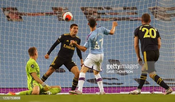 Manchester City's English midfielder Phil Foden scores his team's third goal past Arsenal's German goalkeeper Bernd Leno during the English Premier...