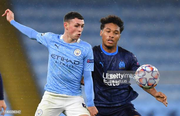 Manchester City's English midfielder Phil Foden vies with Marseille's French defender Boubacar Kamara during the UEFA Champions League 1st round day...