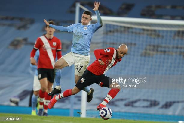 Manchester City's English midfielder Phil Foden vies with Southampton's English midfielder Nathan Redmond during the English Premier League football...