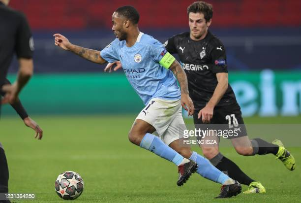 Manchester City's English midfielder Raheem Sterling and Moenchengladbach's German midfielder Jonas Hofmann vie for the ball during the UEFA...