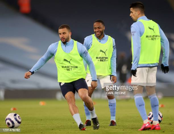 Manchester City's English midfielder Raheem Sterling and Manchester City's English defender Kyle Walker warms up ahead of during the English Premier...