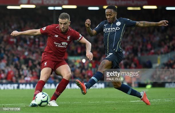 Manchester City's English midfielder Raheem Sterling blocks a cross from Liverpool's English midfielder Jordan Henderson during the English Premier...