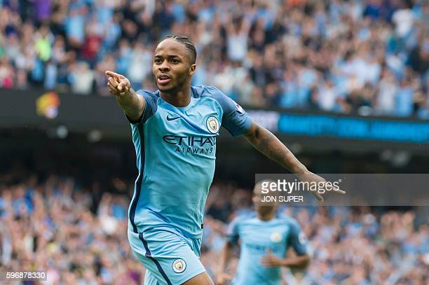 Manchester City's English midfielder Raheem Sterling celebrates after scoring the opening goal of the English Premier League football match between...