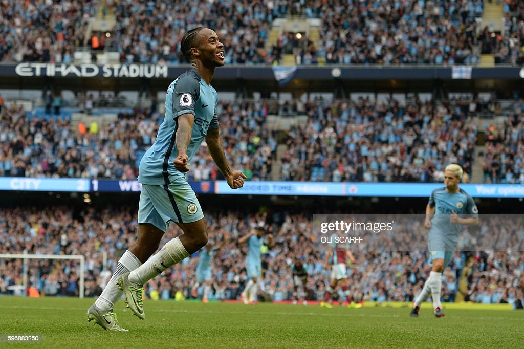 Manchester City's English midfielder Raheem Sterling celebrates after scoring during the English Premier League football match between Manchester City and West Ham United at the Etihad Stadium in Manchester, north west England, on August 28, 2016. / AFP / OLI SCARFF / RESTRICTED TO EDITORIAL USE. No use with unauthorized audio, video, data, fixture lists, club/league logos or 'live' services. Online in-match use limited to 75 images, no video emulation. No use in betting, games or single club/league/player publications. /