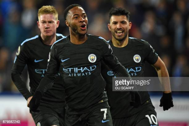 Manchester City's English midfielder Raheem Sterling celebrates after scoring their second goal during the English Premier League football match...