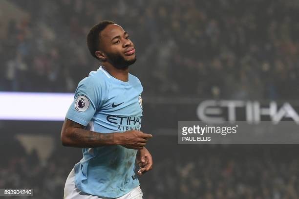Manchester City's English midfielder Raheem Sterling celebrates after scoring their third goal during the English Premier League football match...